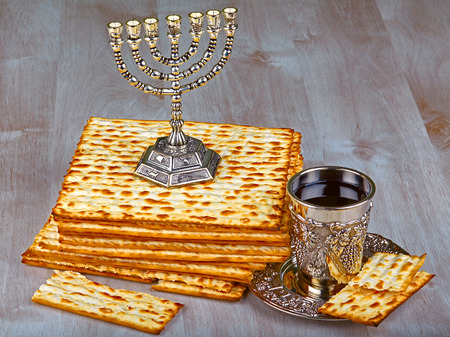 matzah: Closeup of Matzah on Plate which is the unleavened bread served at Jewish Passover dinners Stock Photo