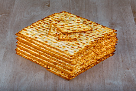 dinners: Closeup of Matzah on wooden table which is the unleavened bread served at Jewish Passover dinners Stock Photo