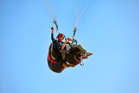 A man and woman paragliding