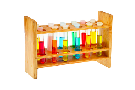 test tube holder: Colorful test tubes in a old fashioned wooden rack isolated over a white background