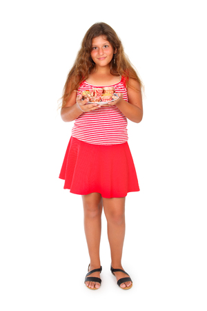 jewess: a girl in red is holding a platter of cupcakes Stock Photo