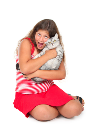 scottish straight: young girl with a scottish cat in her arms