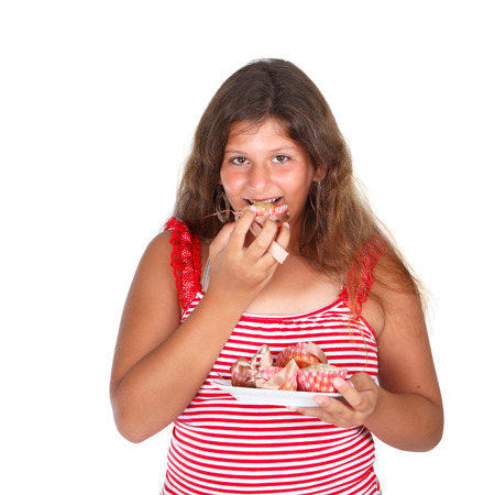 jewess: a girl in red is eating a cupcakes
