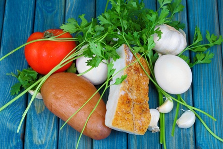rustic food: Boiled eggs and potatoes with lard and vegetables on rustic wooden table