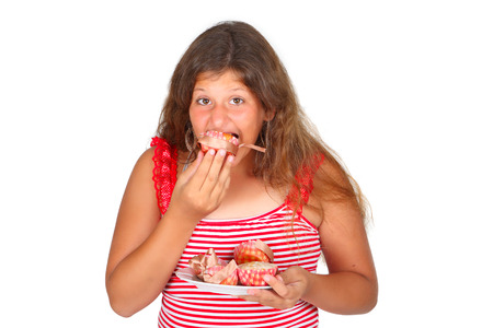 a girl in red is eating a cupcakes