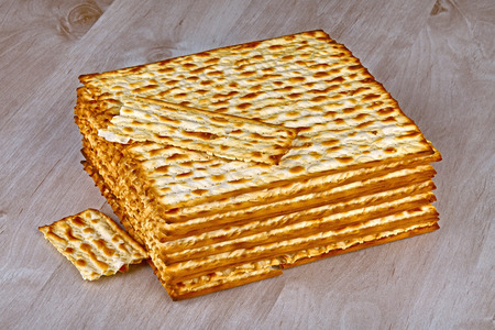 passover: Closeup of Matzah on wooden table which is the unleavened bread served at Jewish Passover dinners Stock Photo