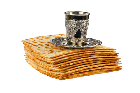 matzot: passover matzo and wine cup isolated on white background Stock Photo