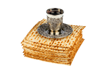 matzot: passover matzo with kiddush cup of wine isolated on white background