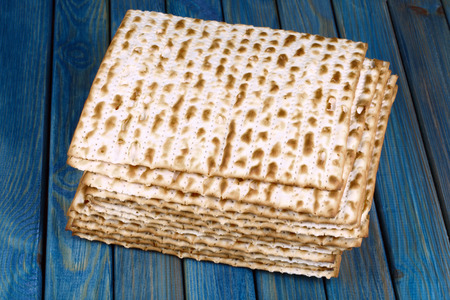 matzah: Closeup of Matzah on wooden table which is the unleavened bread served at Jewish Passover dinners Stock Photo