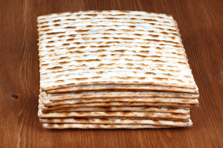 dinners: Matzah on wooden table which is the unleavened bread served at Jewish Passover dinners Stock Photo