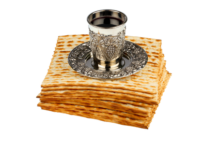 matzo: passover matzo with kiddush cup of wine isolated on white background