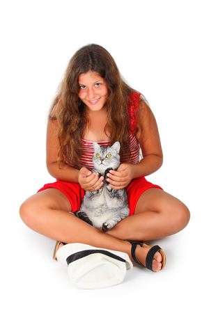 scottish female: young girl with a scottish cat in her arms