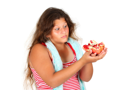 healthy looking: young girl with fresh pomegranate