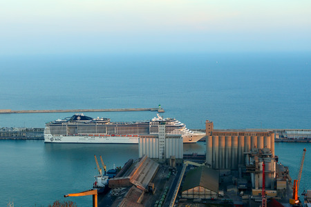 loading dock: BARCELONA, SPAIN - december 12, 2015: View of the loading dock of goods and cruise terminal at the port of Barcelona, Spain