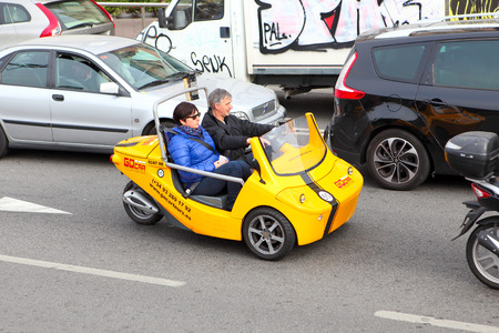 different way: BARCELONA, SPAIN - december 12, 2015: Tourist in a GoCar in the streets of Barcelona. GoCar is a two-seater, 3 wheeled vehicle for the purpose of being rented to tourists as a different way to see a city Editorial