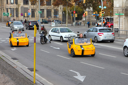 different way: BARCELONA, SPAIN - december 12, 2015: GoCar in the streets of Barcelona. GoCar is a two-seater, 3 wheeled vehicle for the purpose of being rented to tourists as a different way to see a city