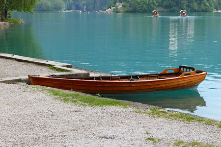 bled: Lonely rowing boat on lake Bled, Slovenia-Europe Stock Photo