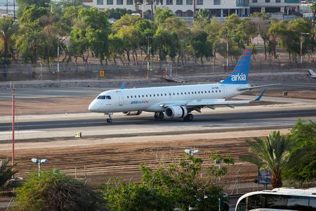 eilat: Eilat, Israel - July 31, 2016: 4X-EMD Arkia - Israeli Airlines Embraer ERJ-190AR  landed at the airport of Eilat