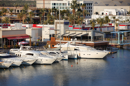 motor boats: Eilat, Israel - July 31, 2016: view on the marina with moored motor boats bob on the waves