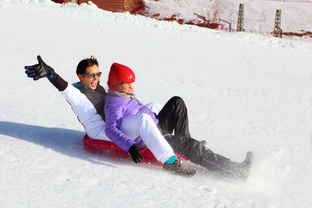 winter vacation: Mother and her daughter enjoying sleigh ride.Outdoor winter fun for family Christmas vacation
