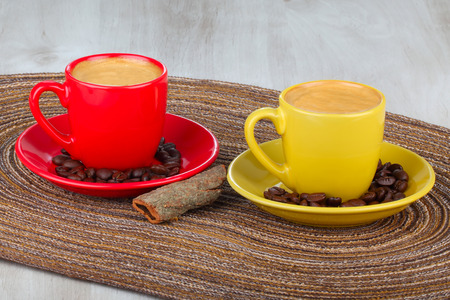 coffee cups: Two cups of coffee with coffee beans Stock Photo
