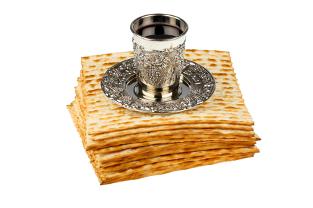kiddush: passover matzo with kiddush cup of wine isolated on white background