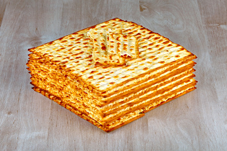 Closeup of Matzah on wooden table which is the unleavened bread served at Jewish Passover dinners