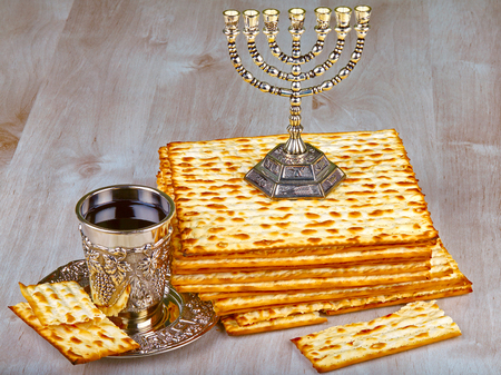 pesakh: passover matzo with kiddush cup of wine on wooden table  Stock Photo