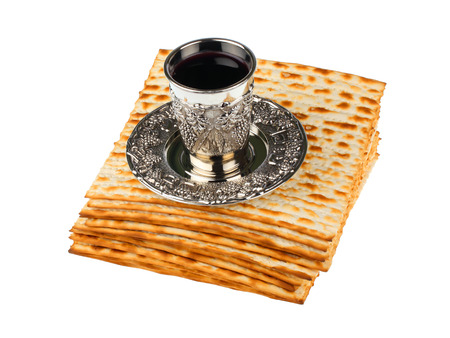 passover matzo with kiddush cup of wine isolated on white background
