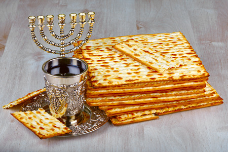 matzah: passover matzo with kiddush cup of wine on wooden table  Stock Photo
