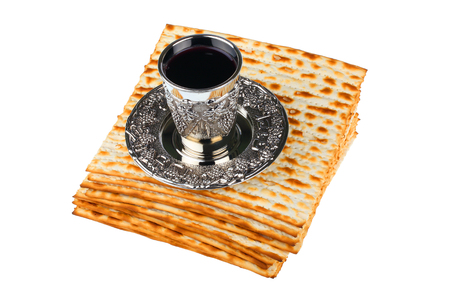 matzah: passover matzo with kiddush cup of wine isolated on white background
