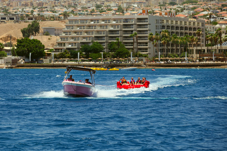 Eilat, Israel - JUNE, 23, 2017:  Sea extreme sport . Happy people on water attractions