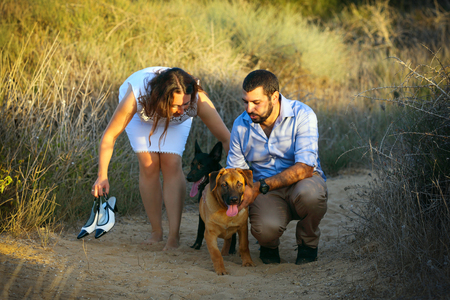 cute guy: A young couple walk their two dogs