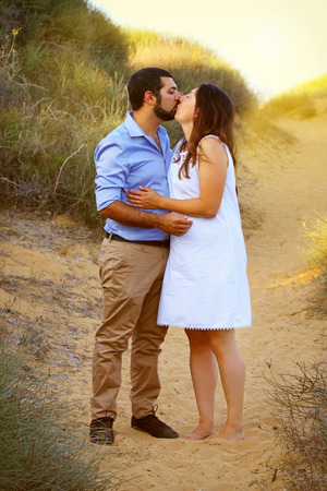 Romantic couple embracing at the beach Stock Photo