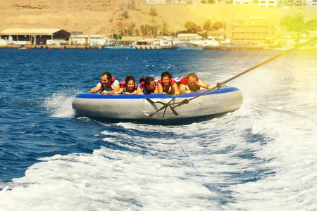Eilat, Israel - JUNE, 24, 2017:  Sea extreme sport . Happy people on water attractions