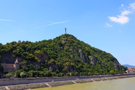 A view across the River Danube towards the Gellert hill in Budapest in Buda District on a summers day