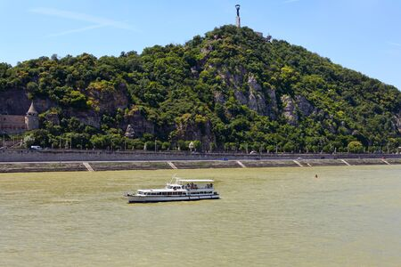 A view across the River Danube towards the Gellert hill in Budapest in Buda District on a summer's day Stockfoto - 133245937