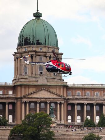 BUDAPEST, HUNGARY - JUNE 23, 2018:A Red Bull aerobatic helicopter demonstrates different flying techniques during an open for the public air show at the city of Budapest.