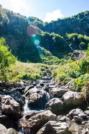 Mountain Creek and beautiful waterfall. Cascade of motion water