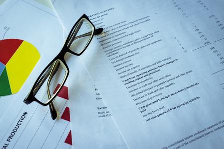 Financial analysis - income statement, business plan with glass. business balance, income statement financial analyze 版權商用圖片