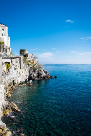 Amalfi cityscape on coast with cristal water of mediterranean sea, Positano, Amalfi Coast, Campania, Sorrento, Italy.