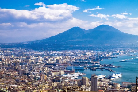 Napoli (Naples) and volcano Vesuvius in the background at sunset in a summer day, Italy, Campania Stock Photo