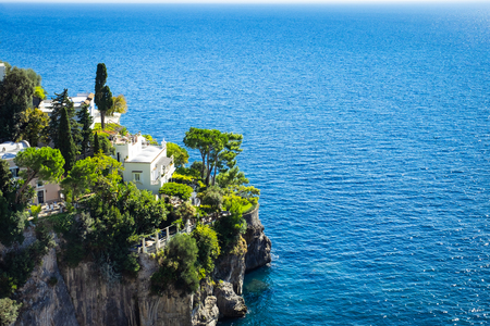 Italian house on a cliff near tyrrhenian sea coast, Amalfi coast, Italy.