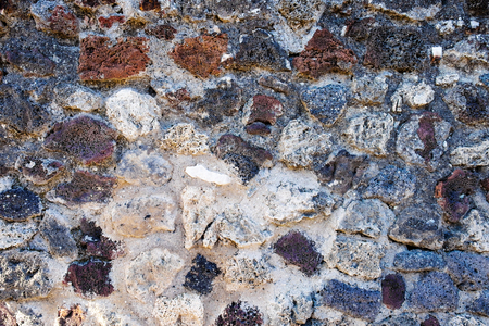 ancient lava stone wall background or texture