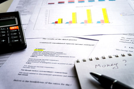 Analyzing business report with charts and diagrams. Business planning concept. Accounting data. 版權商用圖片