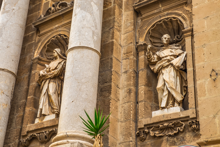 statue on facade of Cathedral church of Palermo.Beautiful Italian temple. 写真素材