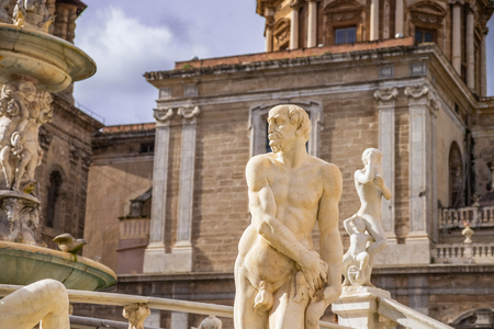 Statue of man in Praetorian Fountain in centre of Piazza Pretoria with detail of ancient Greek Mythology. Palermo, Sicily