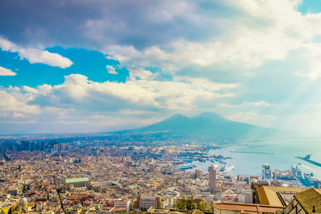 Napoli or Naples and mount Vesuvius in the background at sunset in a summer day, Italy, Campania Reklamní fotografie
