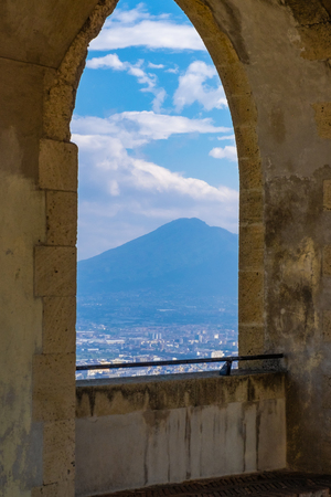 Arch view to the city from ancient castle in Naples, Italy. Cityscape and ancient architecture concept