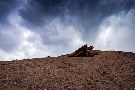 The slopes of the Etna volcano with dramatic sky
